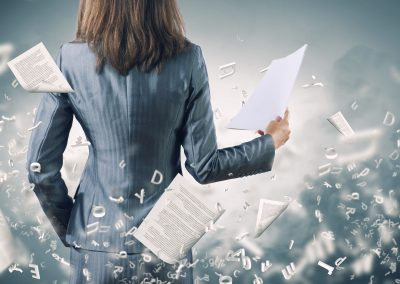 24496526 - back view of businesswoman holding papers in hands